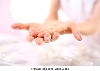 Cosmetic surgery, hand peeling.Massage of female hands peeling preparation Spa & Wellness