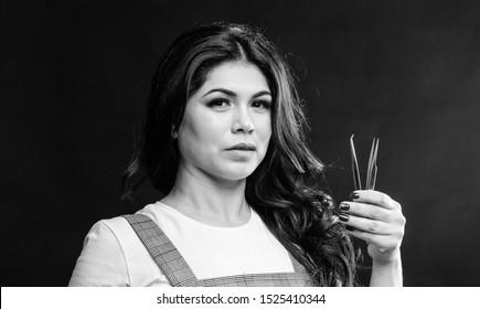 Cosmetic tweezer. Girl makeup face hold tweezer for eyelash extension. Beauty shop concept. Makeup false lashes volume. Lash applicator. Professional eyelash extension tweezer. Makeup artist.