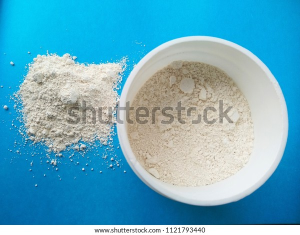 cosmetic white clay on a blue background.
