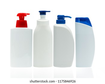 Cosmetic white plastic bottle with red and blue pump dispenser isolated on white background with blank label. Set of four skin care bottle. Body care lotion. Cosmetic jar package. Shampoo bottle.
