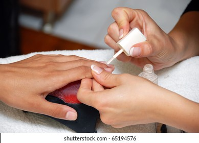 cosmetician hands, making beauty treatment for fingernails and hands