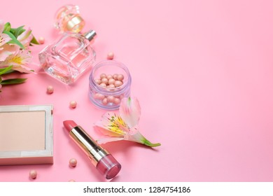cosmetics and accessories on a pink background