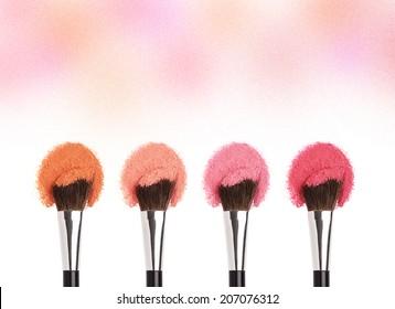 Cosmetics. Cheek powder with make up brushes.