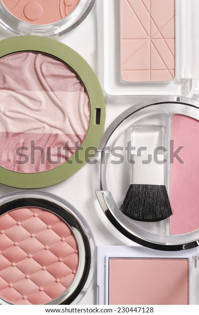 cosmetics composition on white background with light shadows