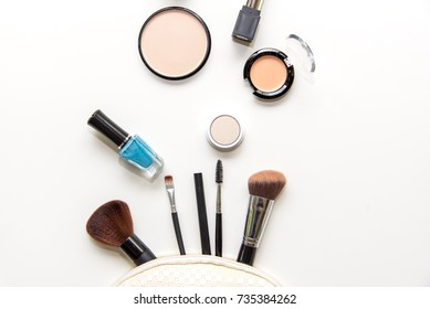 Cosmetics and fashion background with make up artist objects: lipstick, eye shadows, mascara ,eyeliner, concealer, nail polish.  Lifestyle Concept
