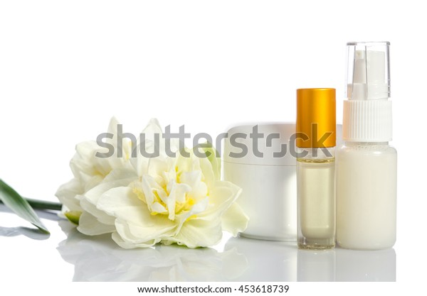 cosmetics with flowers isolated  on white background