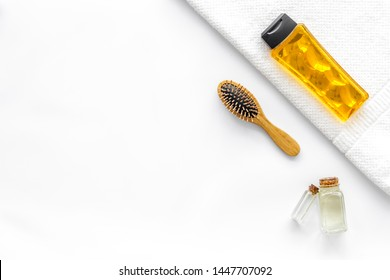 Cosmetics for hair care with jojoba, argan or coconut oil in bottle on white background top view mockup