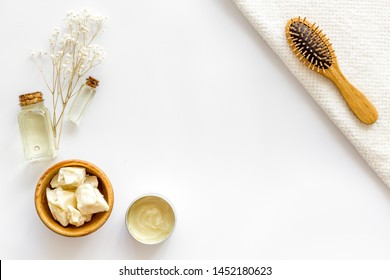 Cosmetics for hair care with jojoba, argan or coconut oil in bottle on white background top view mock up