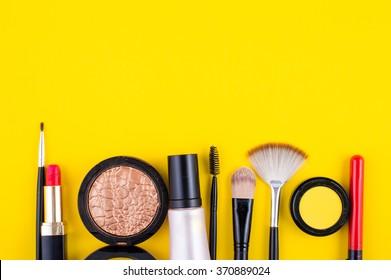 cosmetics lipstick shade brush on a yellow background