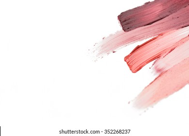 cosmetics, makeup and beauty concept - close up of lipstick smear sample