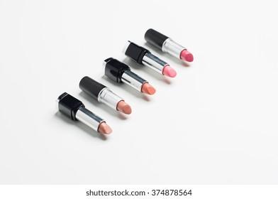 cosmetics, makeup and beauty concept - close up of lipsticks range