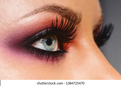 Cosmetics & make-up. Close up woman eye with beautiful shades smokey eyes makeup. Modern fashion make up.