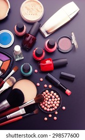 Cosmetics make-up on black background