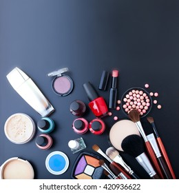 Cosmetics makeup on black background. Top view mock up. Selective focus square.