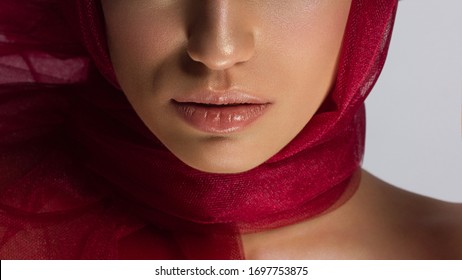 Cosmetics, makeup and trends. Bright lip gloss and lipstick on lips. Closeup of beautiful female mouth with natural lip makeup. Beautiful part of female face. Perfect clean skin in natural light