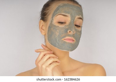 Cosmetics mask of clay on the beautiful young female face