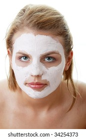 Cosmetics mask of clay on the  young female face