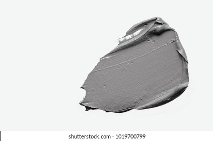 Cosmetics mask gray clay on a white background.