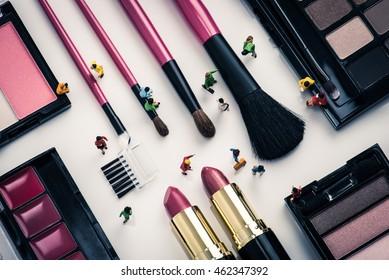 Cosmetics and miniature dolls