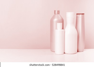 Cosmetics, Moisturizer, Bottle. Different cosmetic bottles isolated on pink. set of cosmetic products. Cosmetic package collection for cream, soaps, foams, shampoo.