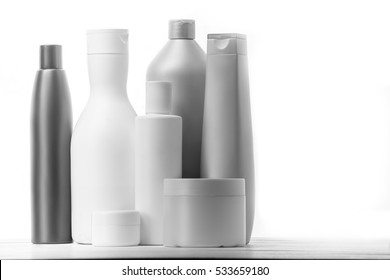 Cosmetics, Moisturizer, Bottle. Different cosmetic bottles isolated on white. set of cosmetic products on a white background. Cosmetic package collection for cream, soups, foams, shampoo.