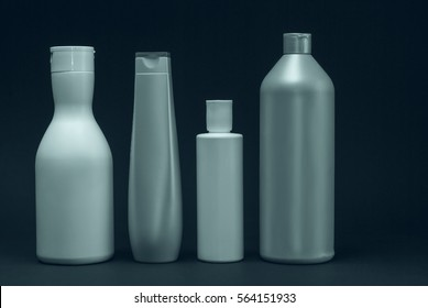 Cosmetics, Moisturizer, Bottle. Different cosmetic bottles isolated on white. set of cosmetic products on a black background. Cosmetic package collection for cream, soups, foams, shampoo.