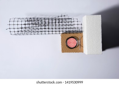 Cosmetics on different platforms like styrofoam, cardbox or a plastic net. Abstract conception.