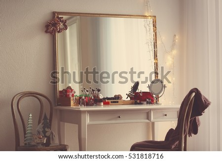 Cosmetics on table in room interior