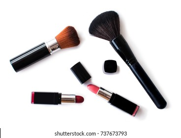 cosmetics on white background or isolate. red and pink lipsticks. Brow brush.
