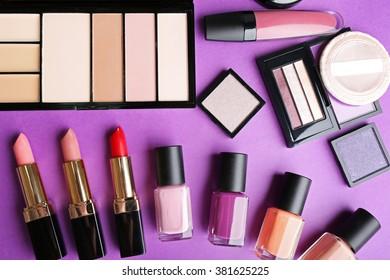 Cosmetics set on purple background
