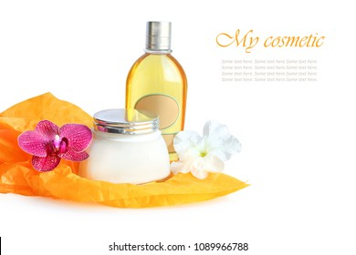 cosmetics set with orchid and petunia flowers on white background. composition
