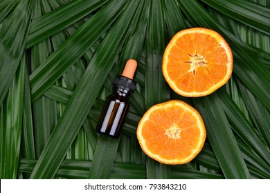 Cosmetics skincare with vitamin-c extract, Cosmetic dropper bottle containers with fresh orange slices, Blank label for branding mock-up, Natural Vitamin C beauty product concept.