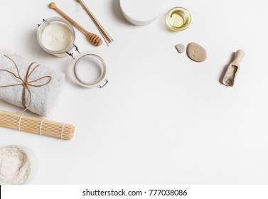 Cosmetics spa and beauty threatment products on white paper background. Space for text. Flat lay. Top view.