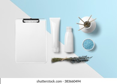 Cosmetics SPA branding mock-up, top view on white and blue background, place your design