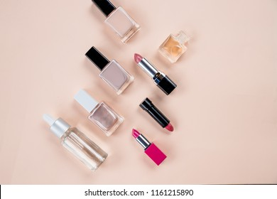 cosmetics top view on beige table. Workplace, cosmetics, lipstick, nail Polish,make up pettern.Set of decorative cosmetics on pastel background.Top view. Copy space.cosmetics, accessories, makeup