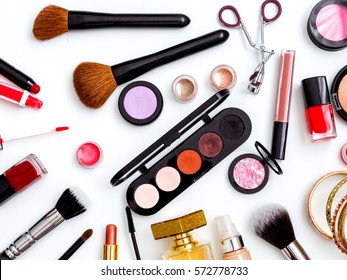 cosmetics top view on a white table. Workplace, cosmetic bag