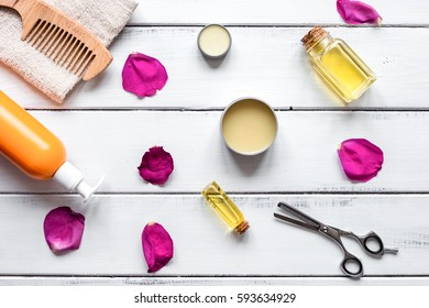 cosmetics for women hair care on wooden background top view