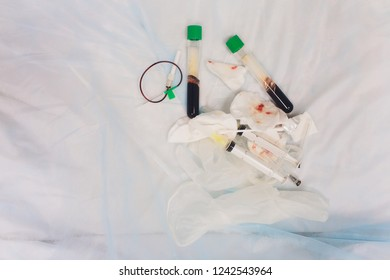 Cosmetologist desk with syringe, bottles and tourniquet used for plasma needling procedure. Vertical shot.