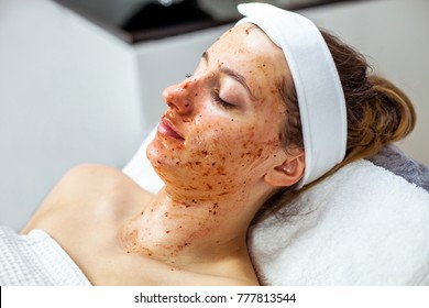 Cosmetologist is doing Face peeling mask, spa beauty treatment for young girl. Model, close-up. Cosmetological clinic. Healthcare