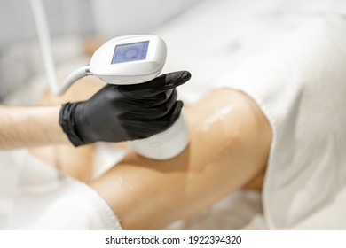 Cosmetologist doing ultrasound liposuction procedure for woman in medical clinic. Beauty anti-age therapy concept. Close up.
