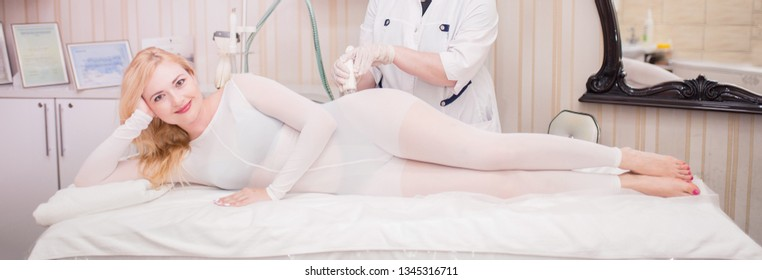 Cosmetologist. Lymphatic drainage massage LPG apparatus process. Woman in white suit getting anti cellulite massage in a beauty SPA salon. LPG, and body contouring treatment in clinic. Beautician.