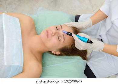 Cosmetologist making mesotherapy injection. Microneedle mesotherapy. Treatment woman at beautician. Hardware cosmetology. Mesotherapy,  treatment of face zone, face rejuvenation.  Close up