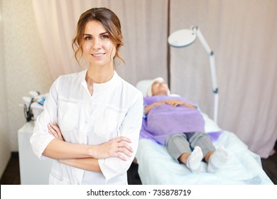 Cosmetologist, portrait of a beautician doctor on the background of the office
