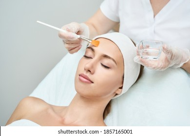 Cosmetology beauty procedure. Young woman skin care. Beautiful female person. Rejuvenation treatment. Facial chemical peel therapy. Clinical healthcare. Doctor hand. Dermatology cleanser.