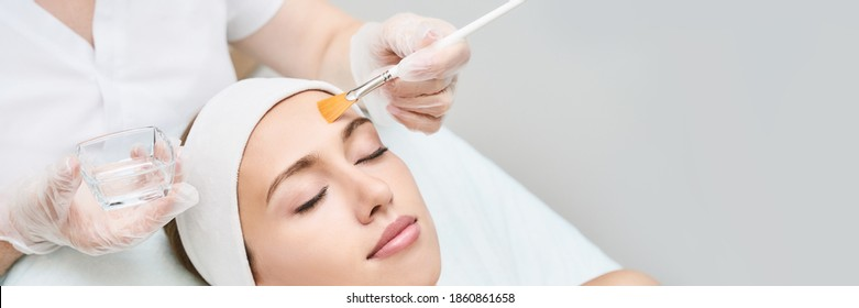 Cosmetology beauty procedure. Young woman skin care. Beautiful female person. Rejuvenation treatment. Facial chemical peel therapy. Clinical healthcare. Doctor hand. Dermatology cleanser. Copyspace