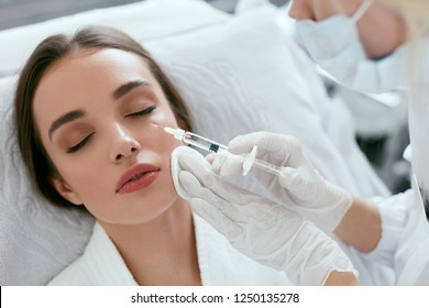 Cosmetology Procedure. Woman Receiving Face Skin Lift Injections
