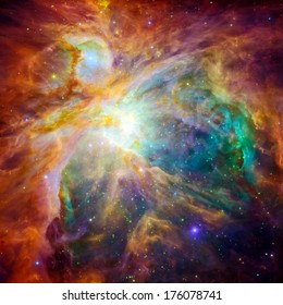 The cosmic cloud Orion Nebula - 1,500 light-years away from Earth. Retouched and cleaned version of original image with infrared and visible-light from Hubble Space Telescopes: NASA/JPL-Caltech/STScI