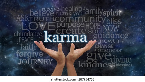 Cosmic Karma - Female hands cupped upwards with the word 'Karma' floating away surrounded by a relevant word cloud on a deep space night sky dark blue  background