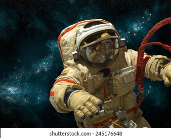 A cosmonaut floats in deep space against a background of stars and nebula. Elements of this image furnished by NASA.