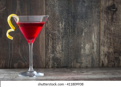 Cosmopolitan cocktail on wood background